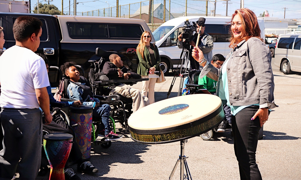 Music Therapy Drum Circle outside adults chicken disabilities wheelchairs camera crew
