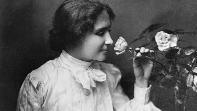 Helen keller, young, smelling rose, black and white photo