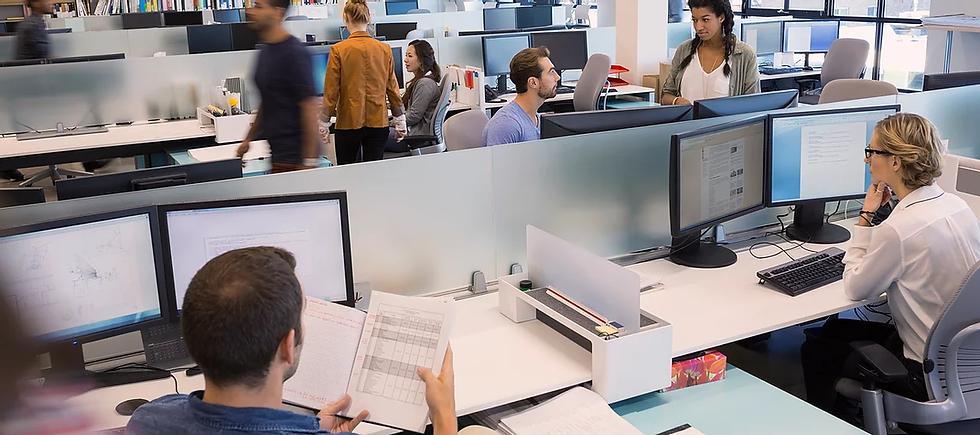 People Working in Open Office.webp