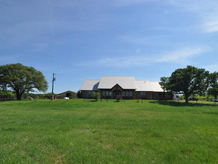 An amazing 157 acre custom home horse ranch with separate living quarters boasting combind 4242 sq f