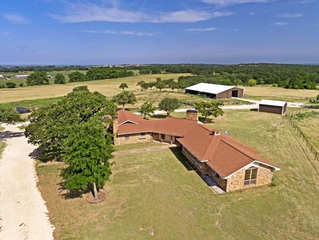 Picturesque 145 acres with multiple stock tanks & significant FM 3025 frontage.