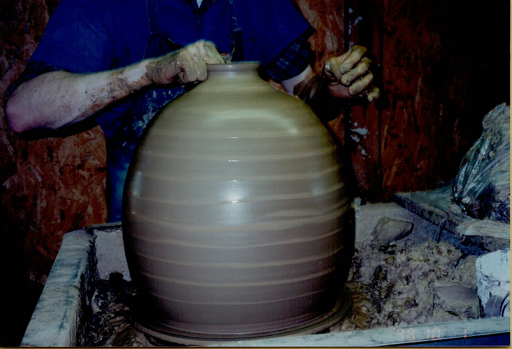 Roger Corn turning 28 pounds of clay into a 12-face jug.