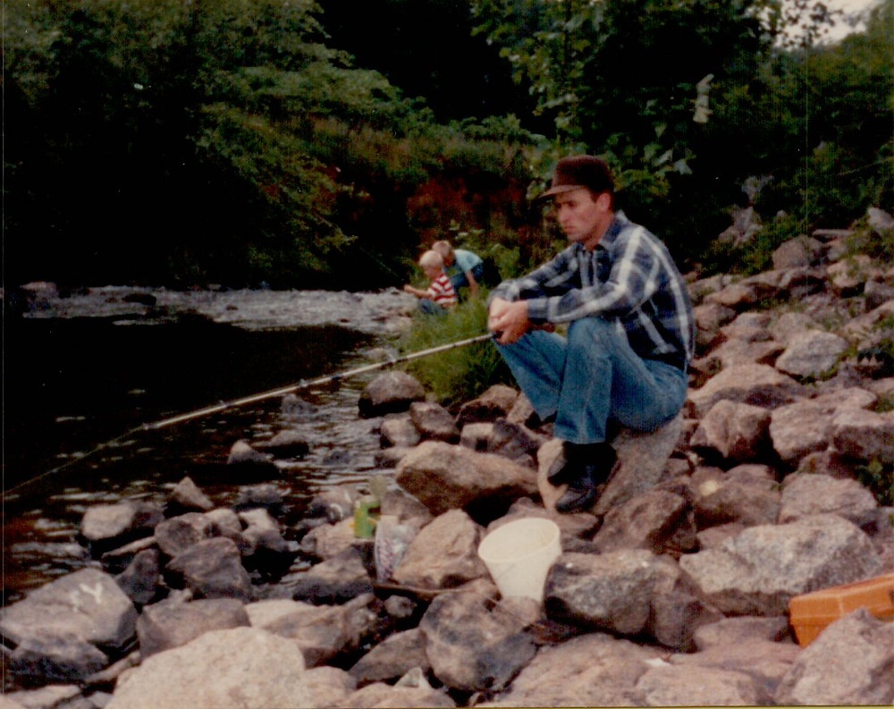 Roger Corn fishing at Commerce Watershed outflow during the early 1990's.