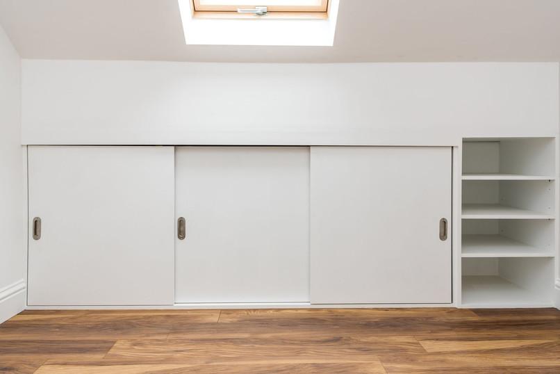 Loft Bedroom - bespoke in built store in