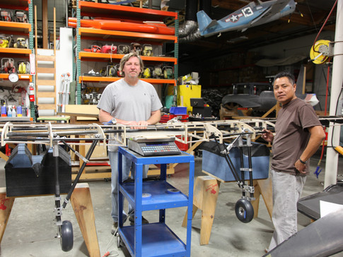 Joe and Cesar taking the weight of the wing with landing gear installed.