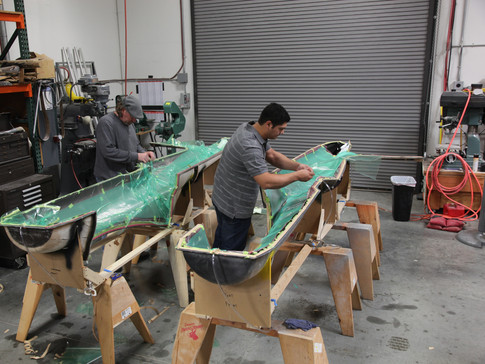 In order to make the new H1 under 125lbs, Joe and Andy prep the molds for the resin infusion process.