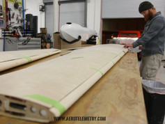 Prepping wings for top sheeting and final leading edge shaping.
