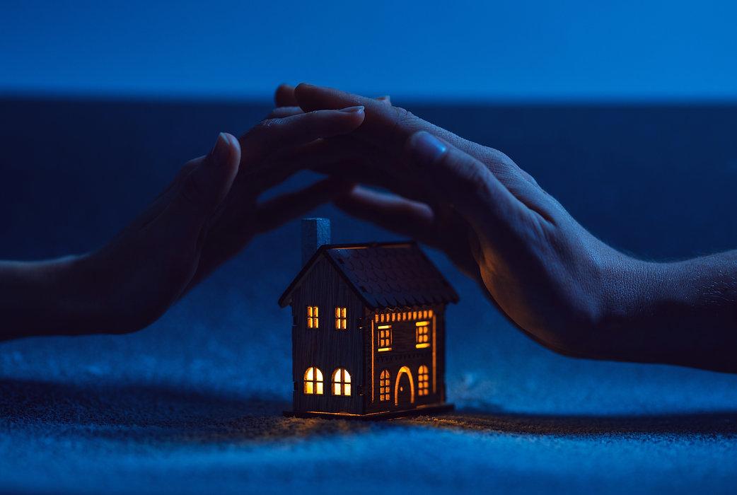 hands over lit house.jpg