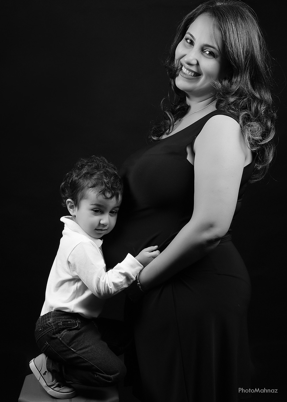Family & Pregnancy Studio Photography in Black Background
