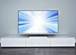 photo of a television on a white piece of furniture