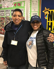 Picture of our parent coordinator with her arm around a parent.