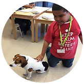 Student posing with our school comfort dog Izzy.