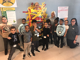 PS596 @ 498 students from class V50 posing with the 498 principal for breast cancer awareness fundraiser.