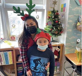 Javien and Ms. Elsie in their holiday hats