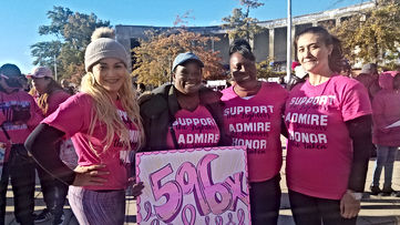 4 staff members participating in the breast cancer walk