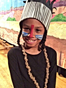 Student dressed in a costume for our Lion King musical.