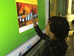 Student interacting with a smart board