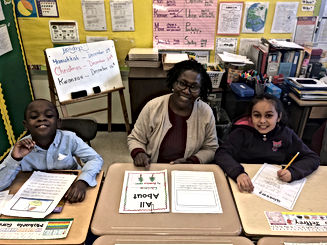 Inclusion students at our P.S. 153 site working on revising and editing their informative writing pieces.