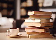 photo of a stack of books and a mug