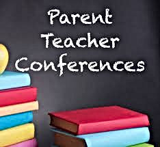 parent teacher conferences written on blackboard with stacks of books