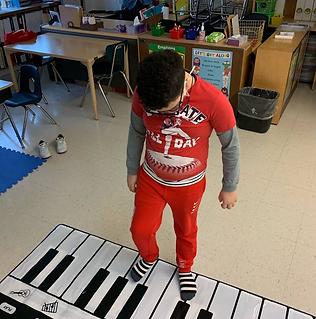 Alejandro playing the floor piano
