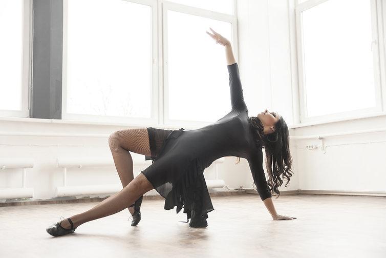 young dancer having rehearsal in studio.