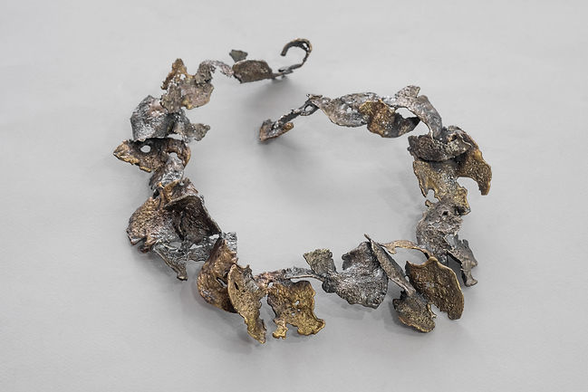 bronze and silver airy collar