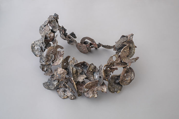 bronze and silver airy metal collar