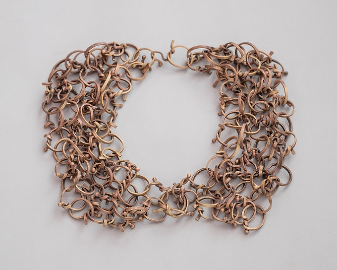 brass collar made of tied matches