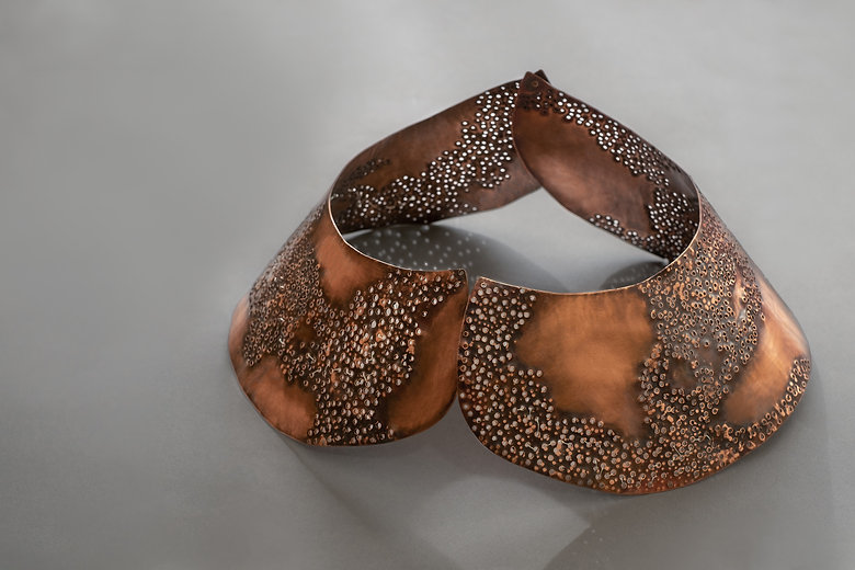 copper and silver perforated collar