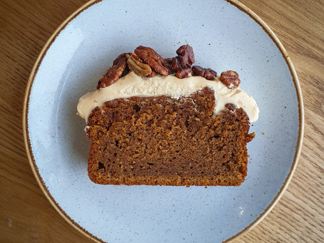 Pumpkin spice cake with maple cream cheese and toasted pecans