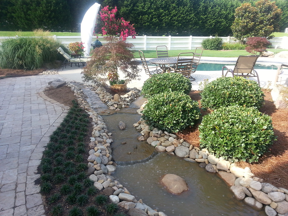 landscape design with stream and patio