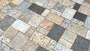 Greenstone granite pavers square installed by Bailey Construction & Landscape Group, Inc