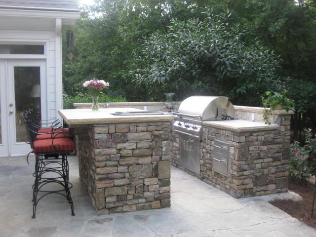 landscape design with outdoor kitchen