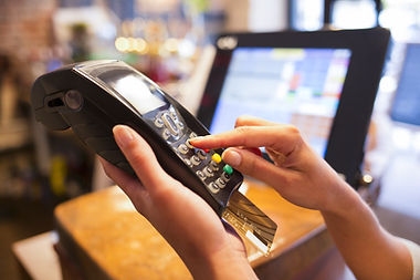 Woman hand with credit card swipe through terminal for sale in restaurant.jpg