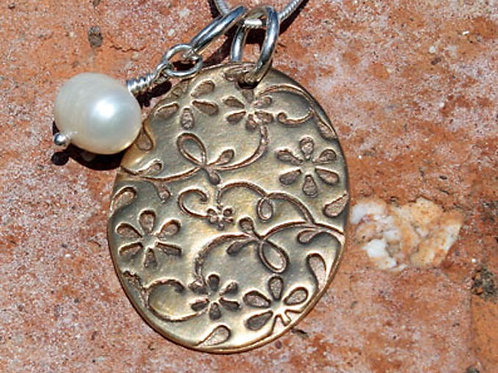 Bronze Textured Pendant with sterling silver detail and pearl charm