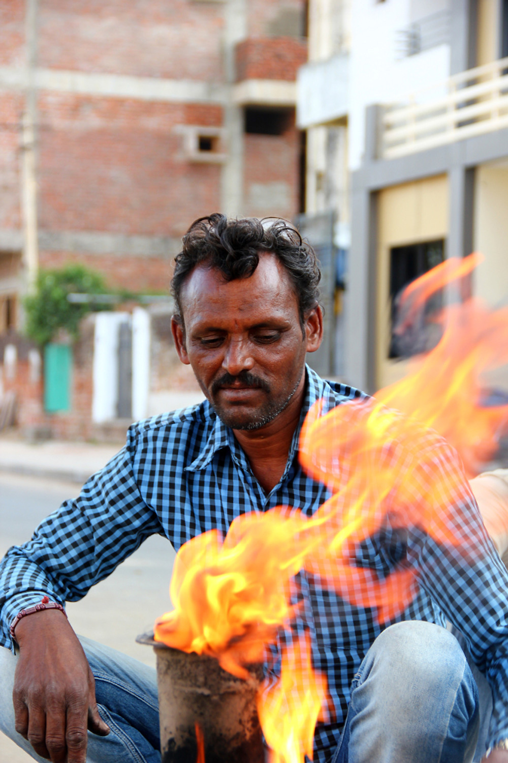 a man using a furnace ieclectica Photograph by Ashwathi