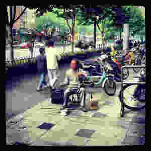erhu/huqin player on the streets of hangzhou china