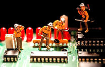 Figurine Doll Utility Workers working on a circuit