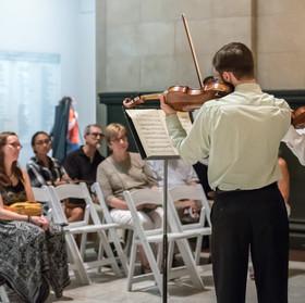 Micah Miller and Vince Phelan, violins.