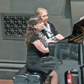 Sonya Szabo-Reynolds & Andrea Arese-Elias played  one piano, four hands.