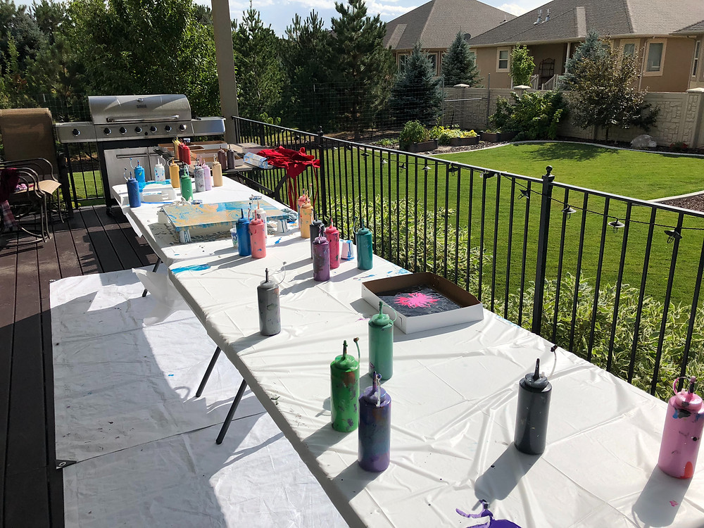 Where did the mess go? We have the mess down to a science. You will never know that you had a paint party when we are done. Tarps, table liners, and parchment paper keep this fun painting easy to clean up.