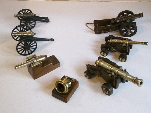 Group of 7 old model cannon.
