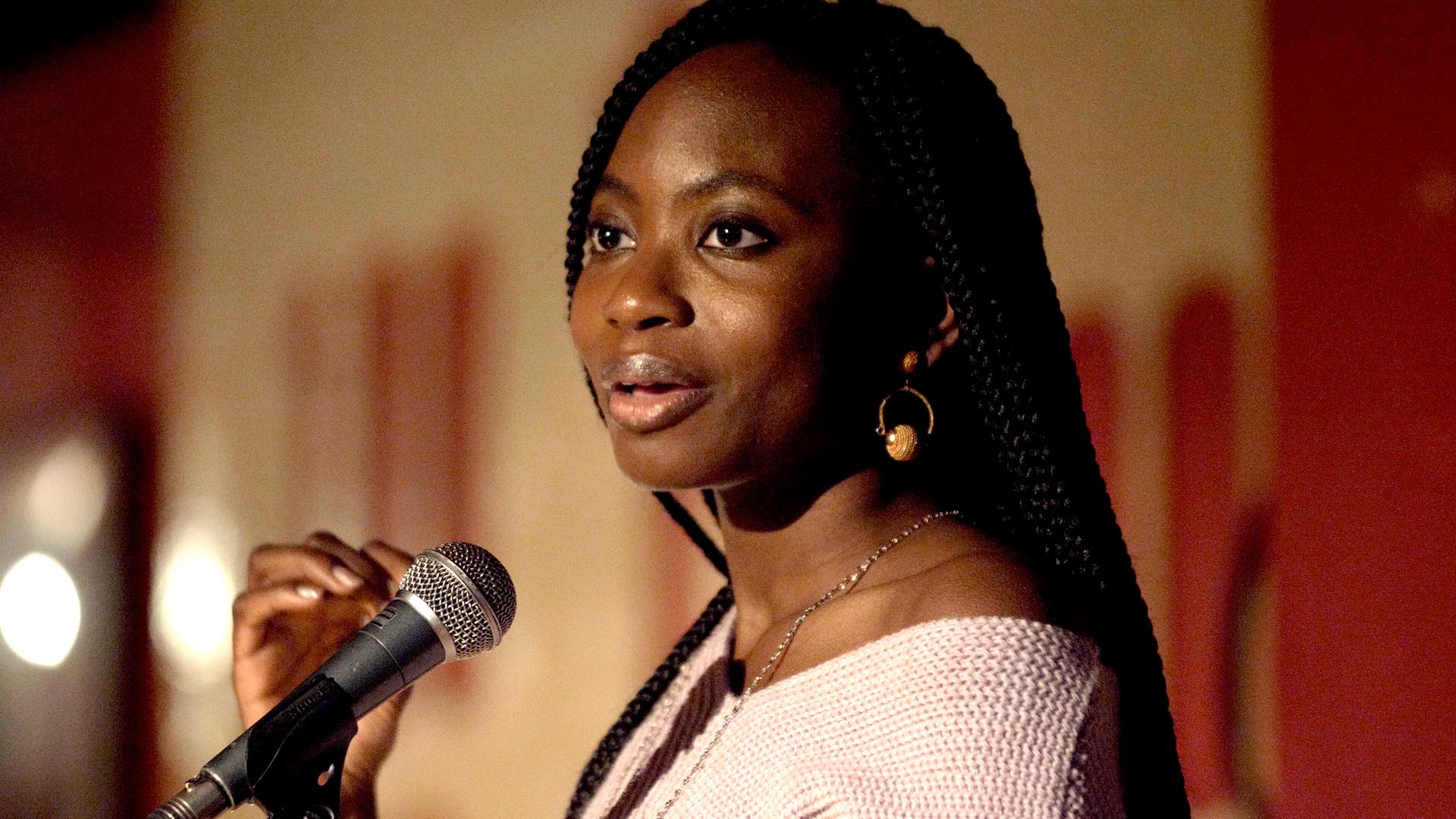 Spoken word artist Angola, performing at Club 100