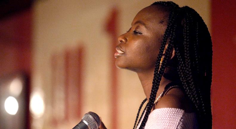 word artist Angola, performing at Club 100