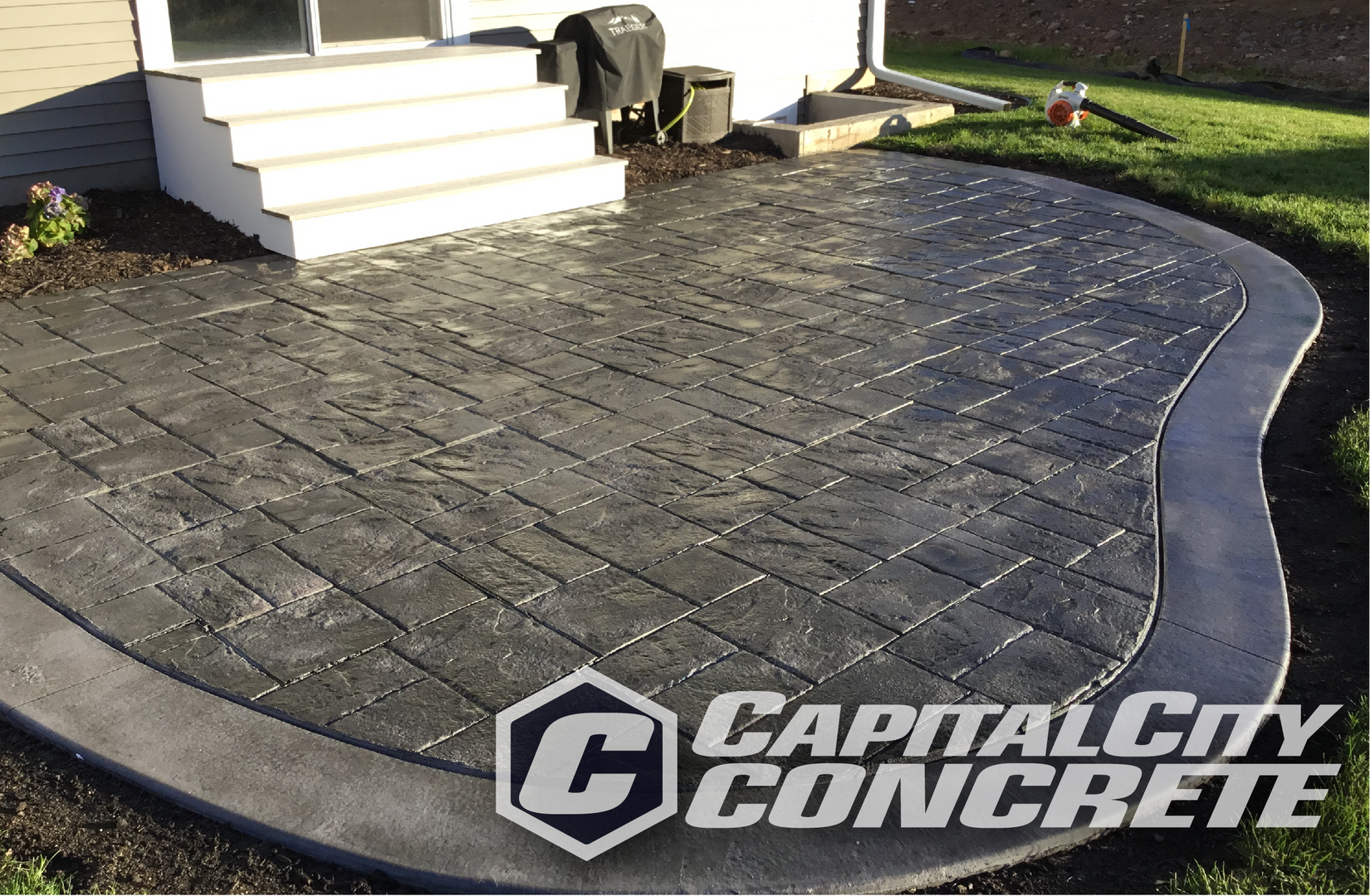 Stamped curved patio.png