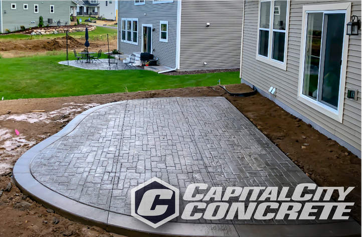Stamped curved patio with smooth border.