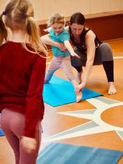 Kids_yoga_activity_for_kids_teacher_adjustment.JPG