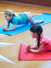 Kids_yoga_activity_for_kids_dophin_plank_pose_closeup.jpg