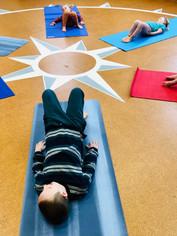 Kids_yoga_activity_for_kids_dophin_bridge_pose.jpg